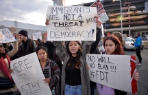 Demonstrators protest President Donald Trump's travel ban outside Philadelphia International Airport.