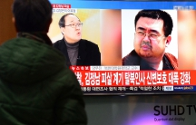 People watch a TV screen broadcasting a news report on the assassination of Kim Jong-nam, the older half-brother of the North Korean leader Kim Jong-un, at a railway station in Seoul, South Korea, on February 14, 2017.