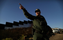 A U.S. border agent patrols the U.S. border with Mexico in Nogales, Arizona, U.S., January 31, 2017.