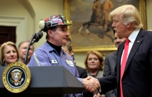 President Trump shakes hands with a coal miner