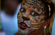 A reveler takes part in the Cordao de Boitata party during pre-Carnival festivities in Rio de Janeiro, Brazil on Feb. 19.