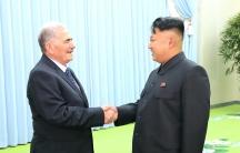 North Korean leader Kim Jong-un (R) meeting Abdullah al-Ahmar, deputy general secretary of Syria's ruling Baath Party, on a visit to Pyongyang in 2013