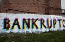 The word 'Bankruptcy' is seen painted on the side of a vacant building by street artists as a statement on the financial affairs of the city on Grand River Avenue in Detroit.