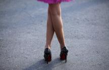 A hostess waits for participants at the Stiletto Run in Constanta, 155 miles east of Bucharest