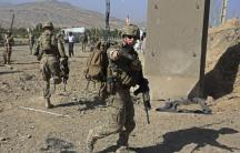 U.S. troops arrive at the site of a suicide attack in Maidan Shar, the capital of Wardak province in Afghanistan, on September 8, 2013.