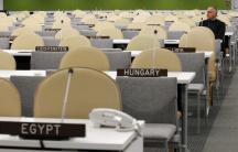 A U.N. worker rests after checking the temporary General Assembly Hall at the U.N. headquarters ahead to the start of the UN general assembly in New York.