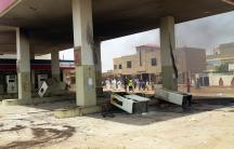 Gas station fuel pumps are toppled during protests over fuel subsidy cuts in Khartoum September 25, 2013