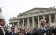US Senate Majority Leader Harry Reid gathers with other Democratic Party senate members and Washington DC Mayor Vincent Gray (L) on the steps of the US Capitol.