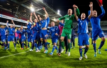 Iceland's team celebrates after their 2014 World Cup qualifying football match against Norway at Ullevaal stadium in Oslo, October 15, 2013.