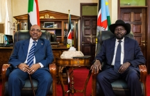 Sudan's President Omar al-Bashir (L) poses for a photograph with his host, South Sudan's President Salva Kiir, at the latter's office in Juba, South Sudan.