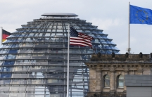 The flag on the US embassy is pictured next to the Reichstag building, seat of the German lower house of parliament Bundestag. A German newspaper said on Sunday that President Barack Obama knew his intelligence service was eavesdropping on Angela Merkel a