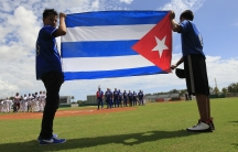 The Cuban flag is displayed during pre-game anthems at exhibition game between members of one of Cuba's most famous baseball teams, Industriale, in Ft. Lauderdale, Florida.