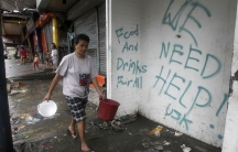 Graffiti calling for help after Typhoon Haiyan devastated Tacloban city, in the central Philippines.
