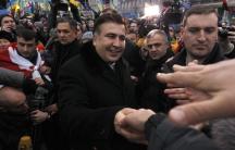 Former Georgian President Mikheil Saakashvili meets pro-European integration protestors in Independence square in Kiev, December 7, 2013.