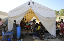 Displaced people stay in makeshift tents inside Tomping United Nations base