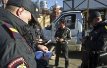 Russian police check a driver's documents in Sochi December 30, 2013.