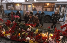 People gather at the site of an explosion on a trolley bus in Volgograd, December 31, 2013