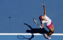 Li Na of China serves to Lucie Safarova of the Czech Republic during their women's singles match at the Australian Open 2014 tennis tournament in Melbourne January 17, 2014.