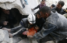 Residents and activists pull a girl from under debris after what activists said were explosive barrels dropped by forces loyal to Syria's President Bashar al-Assad in Aleppo, Syria on February 2, 2014.