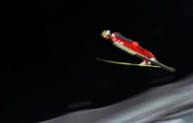 Preliminary events got underway in Sochi Thursday. Here, Poland's Kamil Stoch soars through the air during the men's ski jumping individual normal hill training event. But much attention is still focused on security.