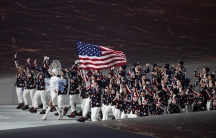 Flag-bearer Todd Lodwick of the U.S. leads his country's contingent during the athletes' parade at the opening ceremony of the Sochi 2014 Winter Olympic Games February 7, 2014. REUTERS/Grigory Dukor (RUSSIA - Tags: OLYMPICS SPORT)