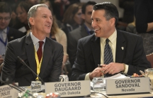 South Dakota Gov. Dennis Daugaard, left, was called out by the Justice Department which says his state has funneled disabled people into nursing homes.