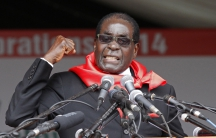 Zimbabwe President Robert Mugabe addresses supporters during celebrations to mark his 90th birthday in Marondera