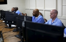 Graduates of a prison computer coding class at work inside San Quentin, in California.