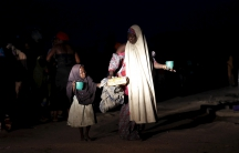 A girl and her mother rescued from Boko Haram in Sambisa Forest by Nigeria's military arrive at a camp for the displaced.