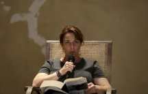 """Cuban artist Tania Bruguera reads from Hannah Arendt's book """"The Origins of Totalitarianism"""" as part of a 100-hour collective reading in Havana May 20, 2015."""