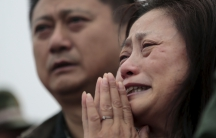 A relative of a missing passenger aboard the capsized ship Eastern Star cries on the banks of the Jianli section of Yangtze River in Hubei province, China, June 4, 2015.