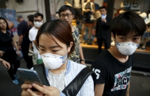 A South Korean woman wears a mask to prevent contracting Middle East Respiratory Syndrome (MERS).   Five new cases were reported by the Health Ministry on Monday, taking the total to 150, the largest outbreak outside of Saudi Arabia. The ministry also sai