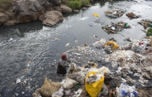A woman recycles plastic bags from a river near the Dondora dumpsite close to the slum of Korogocho in the capital Nairobi, Kenya, March 17, 2015