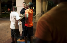 A man reacts while talking to police officer near the scene of shooting at the Emanuel AME Church in Charleston, S.C.
