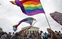 Flag waves in front of Supreme Court Gay Marriage