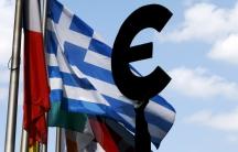 A euro symbol alongside a Greek flag