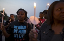 Residents of Chicago's Englewood neighborhood gather for a candlelight vigil against gun violence.