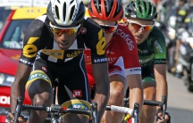 MTN-Qhubeka rider Daniel Teklehaimanot of Eritrea (L) wtih two racers on his tail during a break away in the 6th stage of the Tour de France.