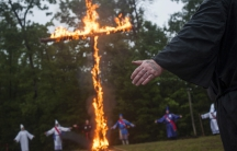 Members of the Nordic Order Knights and the Rebel Brigade Knights, groups that both claim affiliation with the Ku Klux Klan, in a cross lighting ceremony on a fellow member's property in Henry County, Virginia, August 9, 2014.