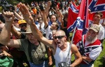 Demonstrators rally at the statehouse in Columbia, South Carolina, July 18, 2015, after state officials decided to remove the Confederate battle flag from the grounds.