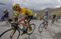 Team Sky rider Chris Froome of Britain (L), race leader's yellow jersey, climbs the Allos pass followed by Astana rider Vincenzo Nibali of Italy during the 161-km (100 miles) 17th stage of the 102nd Tour de France cycling race from Digne-les-Bains to Pra