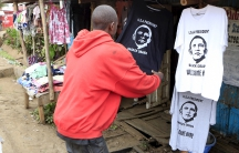 A customer looks at a t-shirt displaying the image of U.S. President Barack Obama at a stall in the Kibera slums, ahead of his scheduled state visit, in Kenya's capital Nairobi July 23, 2015.