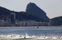 Competitors swim on Copacabana beach in Rio de Janeiro, Brazil