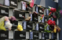 """Flowers are placed on a memorial wall commemorating the late former South and North Korean """"comfort women"""" at the War and Women's Human Rights Museum"""" in Seoul, South Korea, July 22, 2015. """"Comfort women� is the Japanese euphemism for women who were f"""