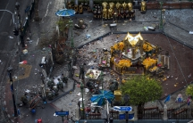 Experts investigate the Erawan shrine at the site of a deadly blast in central Bangkok, Thailand.