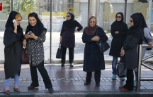 Women wait for a bus in central Tehran, Iran August 24, 2015.