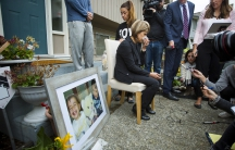Tima Kurdi, sister of Syrian refugee Abdullah Kurdi whose sons Aylan and Galip and wife Rehan were among 12 people who drowned in Turkey trying to reach Greece, cries while speaking to the media outside her home in Coquitlam, British Columbia. A photograp