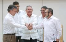 Cuba's President Raul Castro oversees a handshake between Colombia's President Juan Manuel Santos (left) and FARC rebel leader Rodrigo Londono (right), better known by the nom de guerre Timochenko.