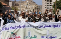 Protesters demonstrate against the Saudi-led air strikes outside the United Nations offices in Yemen's capital Sanaa