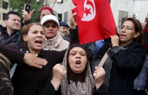 People shout slogans at a protest to condemn a suicide bomb attack in Tunis, Tunisia November 25, 2015.